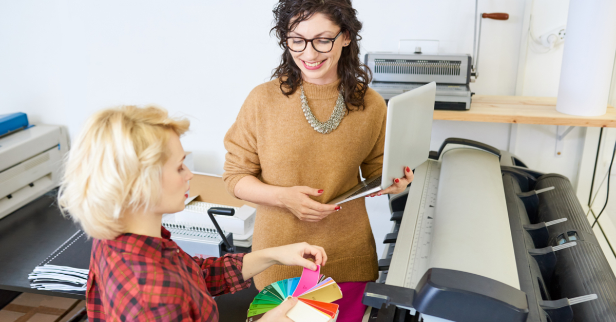 business women using wide format printer