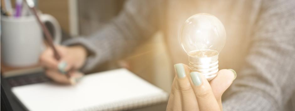 light bulb, woman, paper